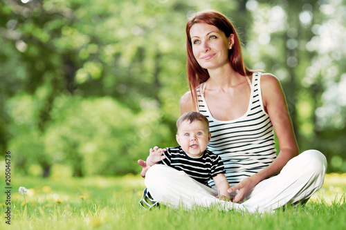 Fototapeta Mother and daughter in park