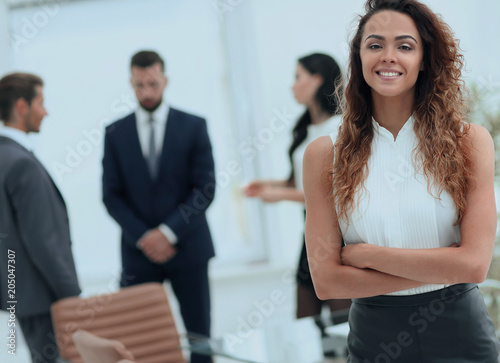 beautiful woman on the background of business people. - 205047307