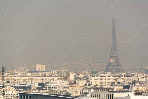Fotobehang Eiffeltoren Aerial view of the Eiffel tower in the fog in Paris. City air pollution concept