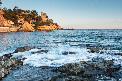 Landscape of Lloret de Mar Castle and its beach in a sunny afternoon, Spain.