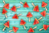 Watermelon slice popsicles on blue wood background, fresh summer fruit concept - 205056731