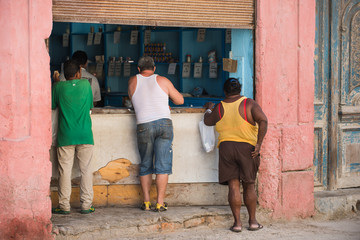 Havana, Cuba. Three people are shopping at a grocery store