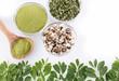 Seeds, leaves and moringa powder. White background - Moringa oleifera