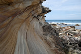 Sydney Australia, base of cliff at Marley beach in the Royal National Park looking out to sea