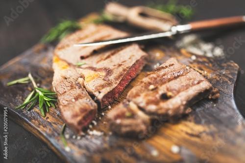 Fotobehang Steakhouse Grilled steak on wooden cutting board