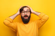 Bearded astonished man on yellow