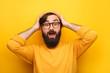 Bearded astonished man on yellow