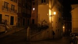 Small street corner with young woman walking on the street, Alfama district in Lisbon. - 205098117