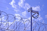 Fence, barbed wire and video camera. - 205107196