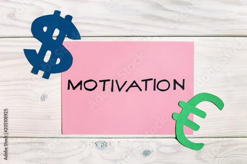 Fototapeta Motivation for earning growth concept on wooden table.