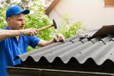 roofer installing bitumen roof sheets - 205110905