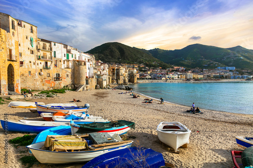 Fotobehang Freesurf Sicily - old town Cefalu with fishing boats on the beach. Italy
