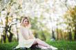 Quadro girl in yellow dress posing in park. short haircut blonde.