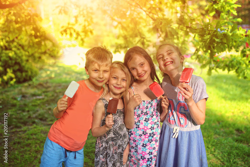 kids eat ice cream on a hot day
