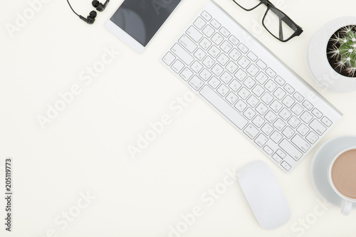 Foto Murales White office desk table with laptop, cup of coffee and supplies. Top view with copy space.