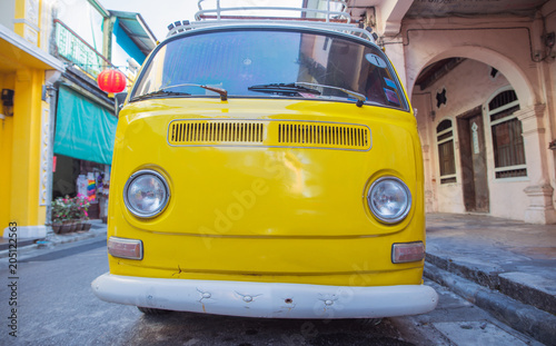 Wall mural Picture of a yellow bus - vacation journey
