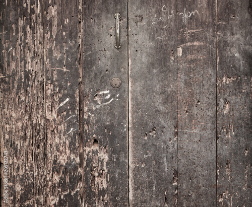 Fotobehang Konrad B. Raggedm rustical door made of old wood