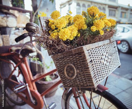 Plexiglas Konrad B. Closeup picture of a vintage bike with flowers in a basket