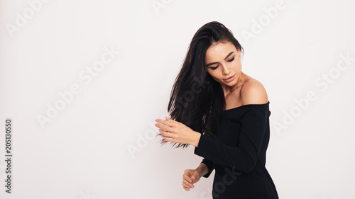 Studio shot of a fashionable woman posing over white background