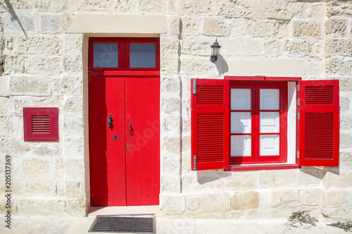Old fashioned red door and window © triocean