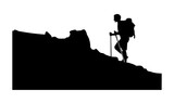 a silhouette of a man on a snowy climb