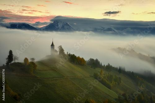 Plexiglas Beige St. Primoz church near Jamnik at dusk with alps in background, Slovenia