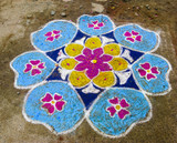 Rangoli. Figure-prayer around the front door. India