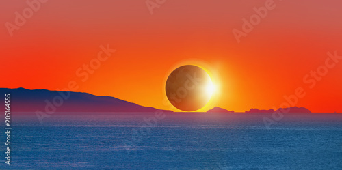 Fotobehang Baksteen Beautiful landscape with Solar Eclipse - Beauty sunset over the sea