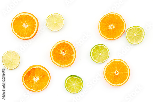 Oranges and lime round slices pattern on white background top view copy space