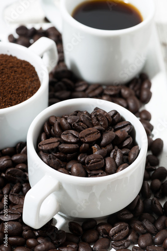 Poster Three types of coffee - ground, grain and beverage in white cups , vertical
