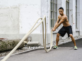 Fitness training outdoors with ropes - 205182562