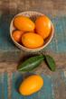 Quadro Delicious small citrus fruits kumquats close up on wooden table