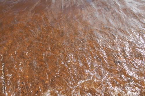 Canvas Stenen water texture orange foam background abstraction