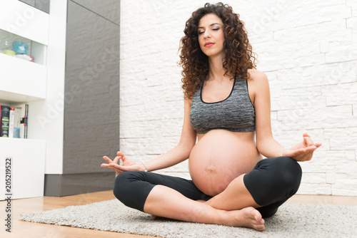 Sticker Pregnant woman doing a yoga exercise