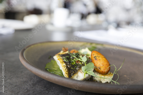 Plate with tasty fish steak on grey background - 205225953