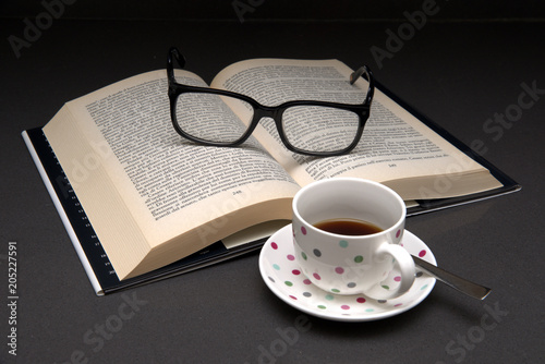 Fototapeta Book and coffee a momento of relax and peace