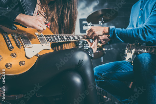 Canvas Muziek Guitar music teacher helping his student to play, closeup on the hands