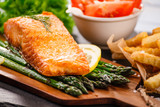 Fried salmon with french fries on wooden table - 205237136