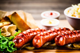 Grilled sausages, baked potatoes and vegetables - 205241726