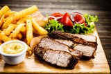 Grilled beefsteak with french fries and vegetables - 205241783