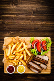 Grilled beefsteak with french fries and vegetables - 205241902