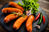 Raw sausages with and vegetables - 205241949