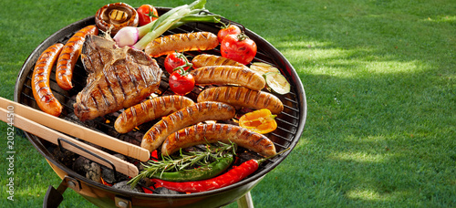 Meat and vegetables grilling on an outdoor BBQ