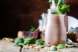 Chocolate milkshake or cocktail with nuts and mint leaves, old wooden background, selective focus - 205253711