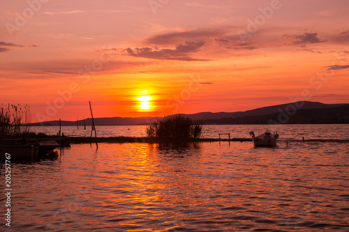 Fotobehang Baksteen Scenery lake landscape with blue sky and sunset