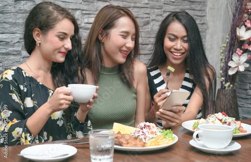 Fototapeta Group of friends having great time in coffee shop
