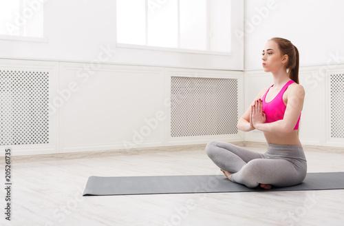 Aluminium School de yoga Woman training yoga in lotus pose.