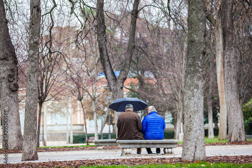 Senior couple on a bench in a city park