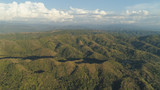Aerial view of mountains covered forest, trees. Tropical landscape: mountains, sky with clouds. on the island of Luzon, Philippines. Mountain province, Cordillera region.