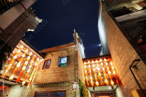 Plexiglas Guilin Looking up at traditional old town architecture in Guilin at night, China.